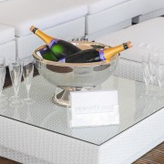 rattan table with champagne bowl