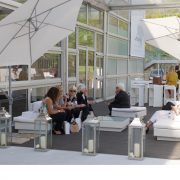 Cantilever umbrellas at event with tall lanterns