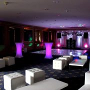 chesterfield silver ottoman in night club