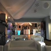 White faux leather club lounge sofas with fairy lights