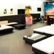 sofa sets with black rattan bases and white cushion covers