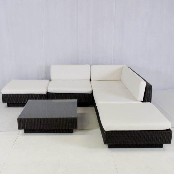 rattan sofa modules set up in a l-shape