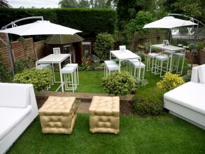 garden furniture hire including gold chesterfield ottomans with kubo bistro sets