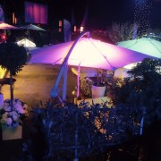 garden umbrella hire with lighting effects at night