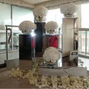 mirror plinths being used to host florist arrangements