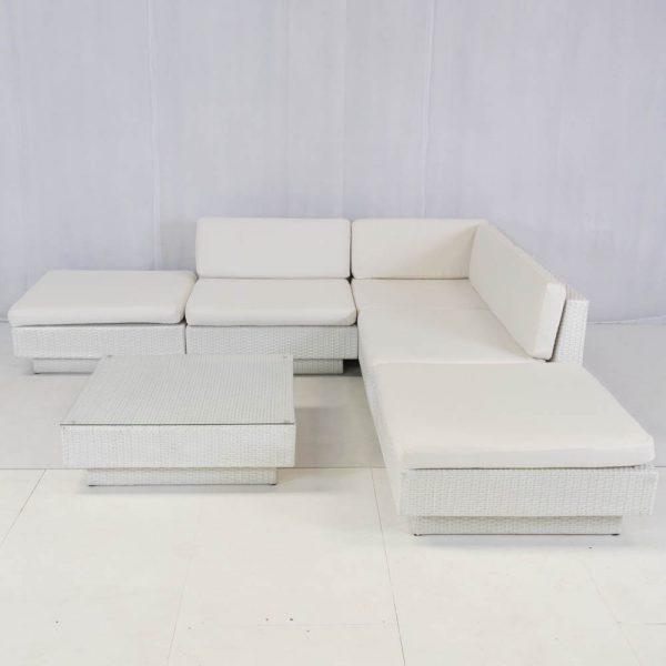 white rattan sofa modules set up in a l-shape: sofa hire