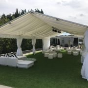 white marrakesh in marquee with striped scatter cushions