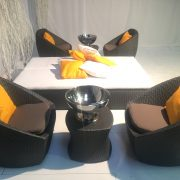 delano tub sets with champagne bowls and orange scatter cushions