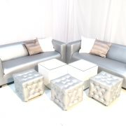 Silver faux leather club lounge sofas with chesterfield ottomans and white faux leather cabo tables