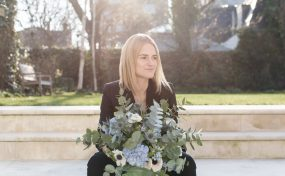 Katrina Otter with bouquet of flowers