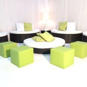 Banyan rattan sofas with lime green scatter cushion and lime ottomans
