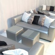 silver club lounge sofas with silver faux leather cabo tables