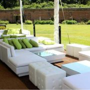 white rattan sofas with olive and lime scatter cushions