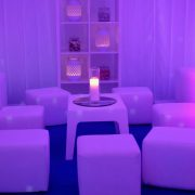 white plastic mambo table and white faux leather cube seats