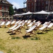 linen deckchair hire set up at an outside festival