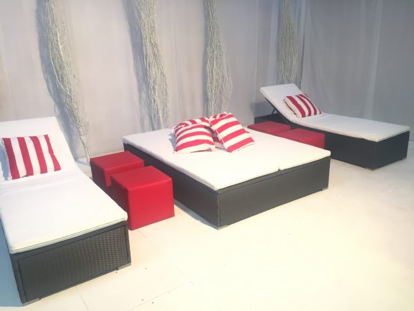 Portofino double and single daybed hire with red stripe scatter cushions and red club ottomans