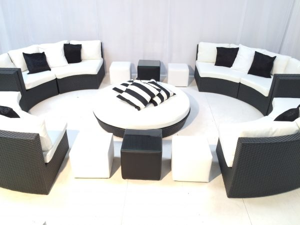 Miami daybed in black with club ottomans, Bulgari curved sofas, and black and white scatter cushions