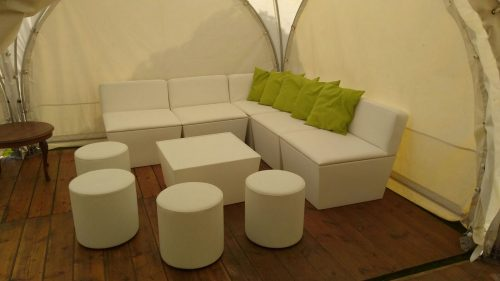 Ana Mandara corner sofa and table modules hired with club poufs ottomans and lime scatter cushions