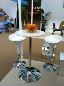 Exhibition Furniture Hire: bar stools and bar with oranges