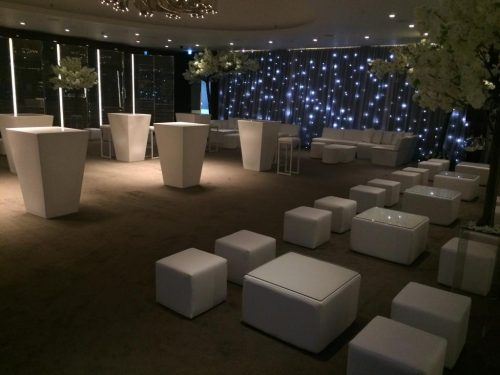 white furniture hire: white poseur table, faux leather cube table with glass top and white faux leather cubed seating at bulgari hotel