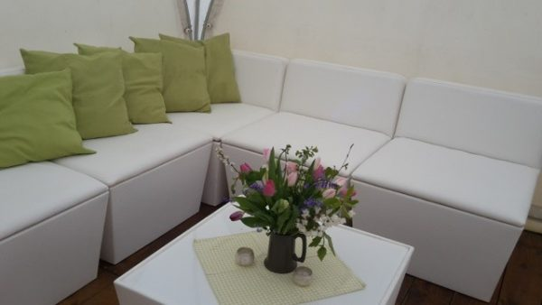 Ana Mandara corner sofa with flowers and lime green scatter cushions