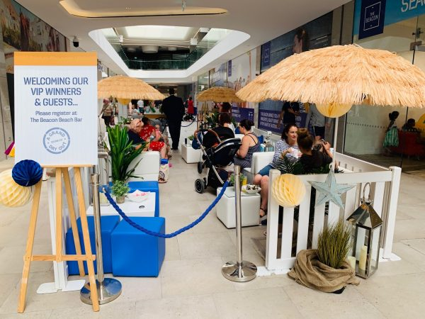 event furniture hire: blue faux leather cube seat and white faux leather cube table shopping centre