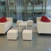 White faux leather club lounge sofa with club coffee table and club ottomans