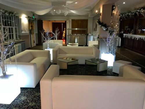 white faux leather club lounge sofas with mirror cubes