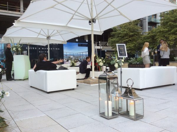 Tall Lantern and Square lantern hired out at Canary Wharf with club sofas and Cantilever umbrellas