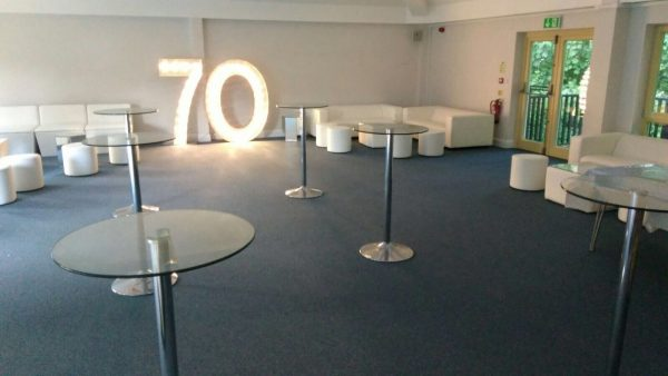 Daiquiri Poseur Tables with Club Sofas and Club Poufs and light up numbers