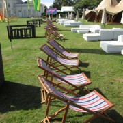 striped deckchair set up at a festival VIP lounge
