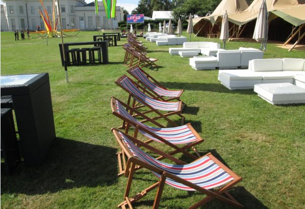 striped deckchair set up at a festival VIP lounge