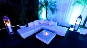 white rattan sofa set with lanterns: venue styling