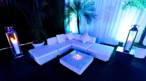 white rattan sofa set with lanterns