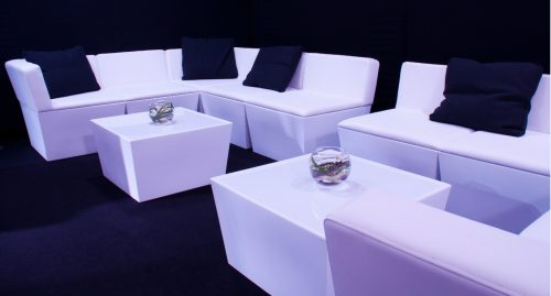 white sofa seating modules placed with mirror cube tables and ottomans for hire