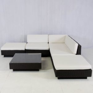 rattan sofa modules set up in a l-shape