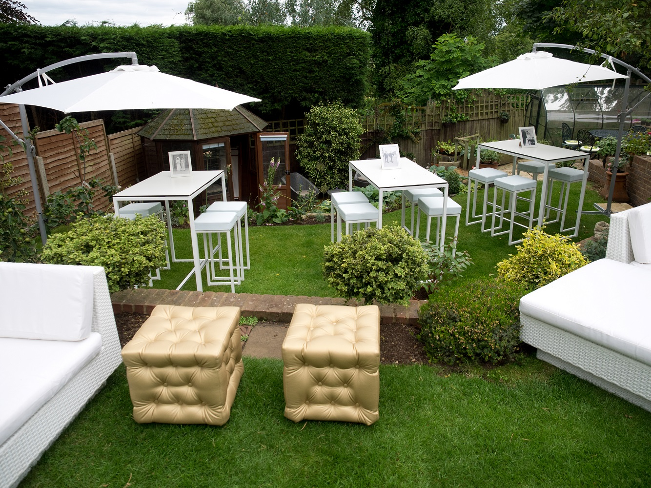 Gold chesterfield ottomans with kubo bistro sets for hire