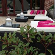 black rattan with cream covers and hot pink scatters