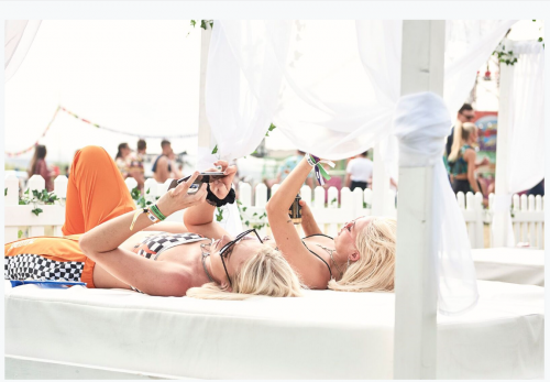ladies lying on four poster antibes daybeds