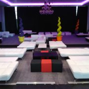 white faux leather daybeds with black cube seats and red cube seats