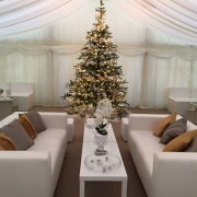 white faux leather sofas in marquee