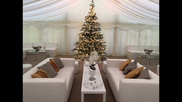 Christmas party furniture hire: white faux leather sofas in marquee