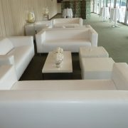 club lounge sofas with large ottomans all in white