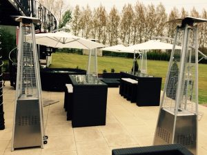cream garden umbrella hire for your summer party: rattan furniture hire