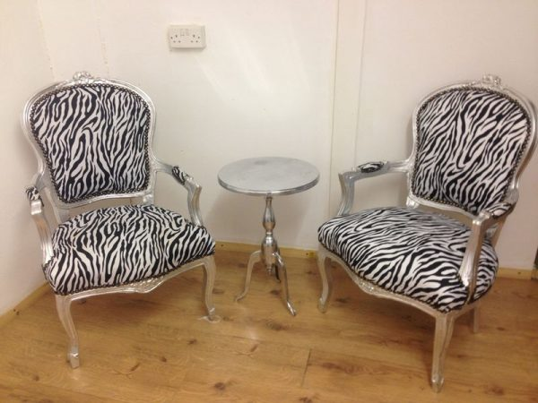 zebra print chair hire with silver frames