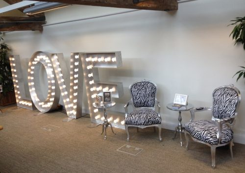 zebra print chair hire with large light up love letters