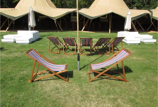 striped deckchairs hire at a festival VIP lounge
