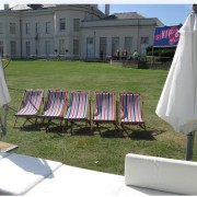 stripe deckchair hire at a festival with garden umbrella hire