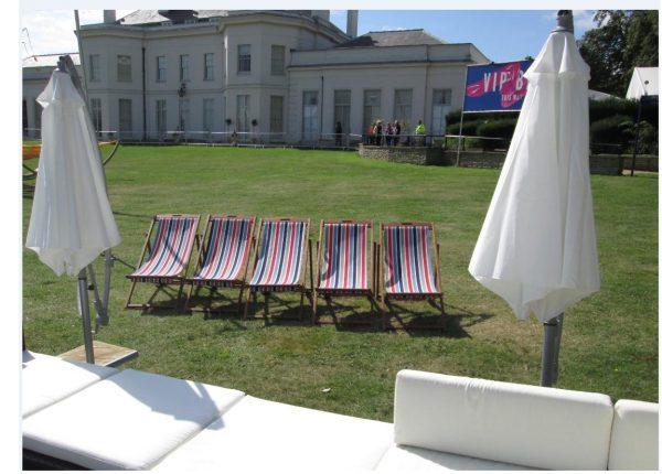 stripe deckchair hire at a festival with garden umbrella hire