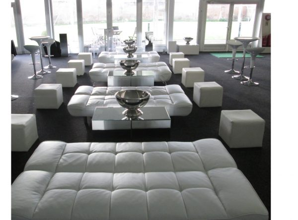 wedding furniture hire: white faux leather cubed seating with white faux leather daybeds, mirrored cube tables and champagne bowls